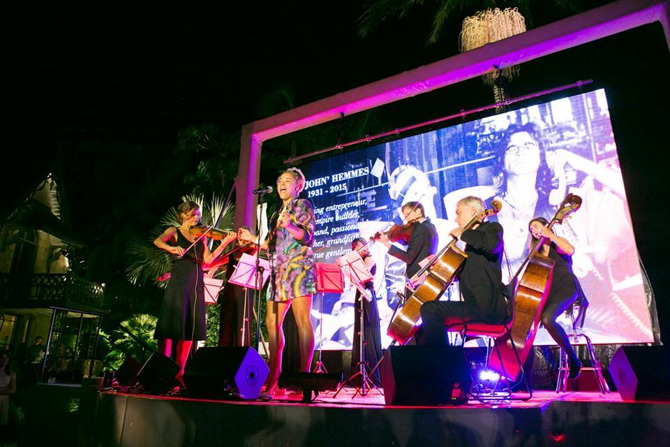 "The Stringspace Orchestra performing ""At Last"" with Connie from Sneaky Sound System at a private event."