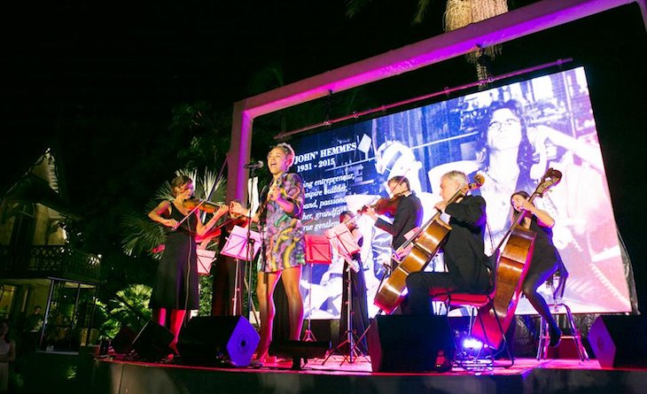"""The Stringspace Orchestra performing """"At Last"""" with Connie from Sneaky Sound System at a private event."""